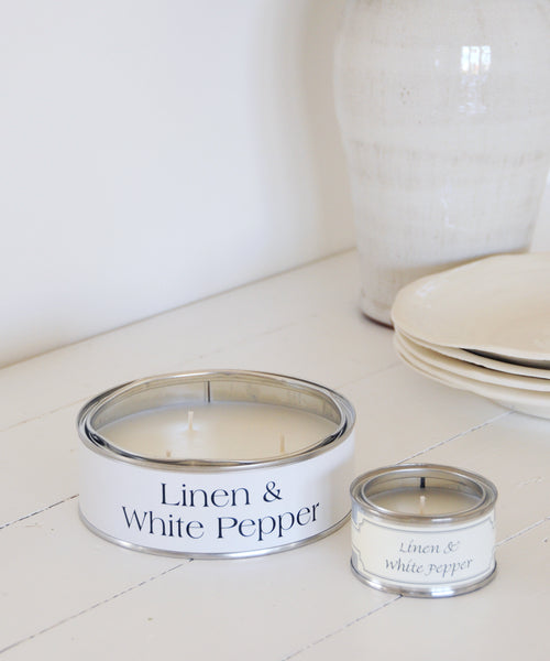 large and small tin candle