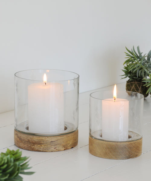 Large and small etched glass hurricane lamp