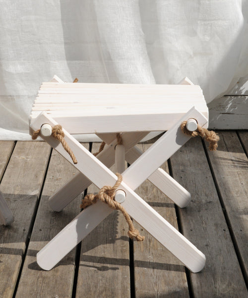 white wood foot rest and side table