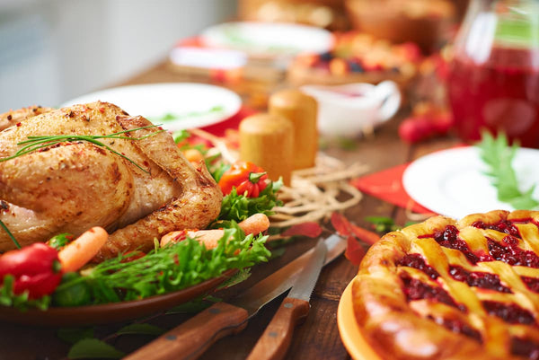 A holiday meal sits on a table setting from Cardi's Furniture and Mattresses