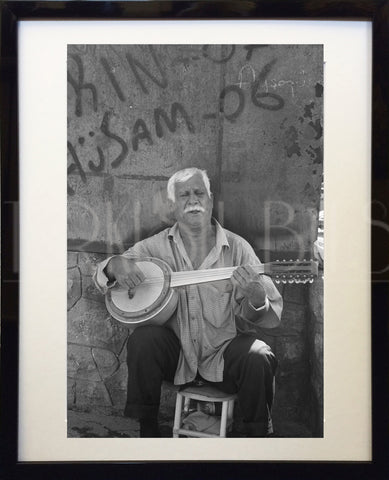'Turkish Gypsy with Banjo' Photography Wall Art - Bohomio