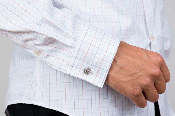 barrel cuff worn with a cufflink on a men's cotton dress shirt