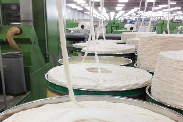 Fabric getting twisted into two-ply