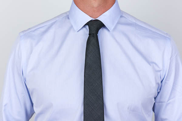 semi spread collar with tie on a men's dress shirt