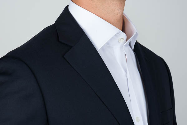 Tall spread collar with blazer from the side