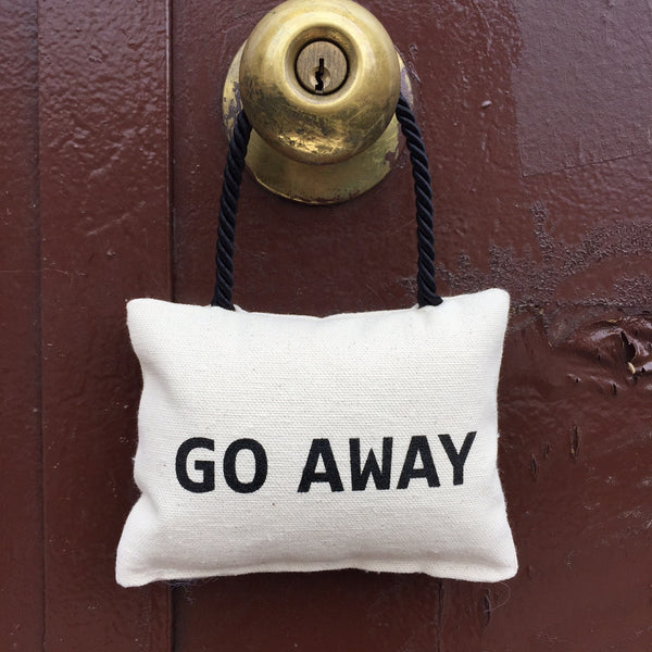 GO AWAY DOOR PILLOW