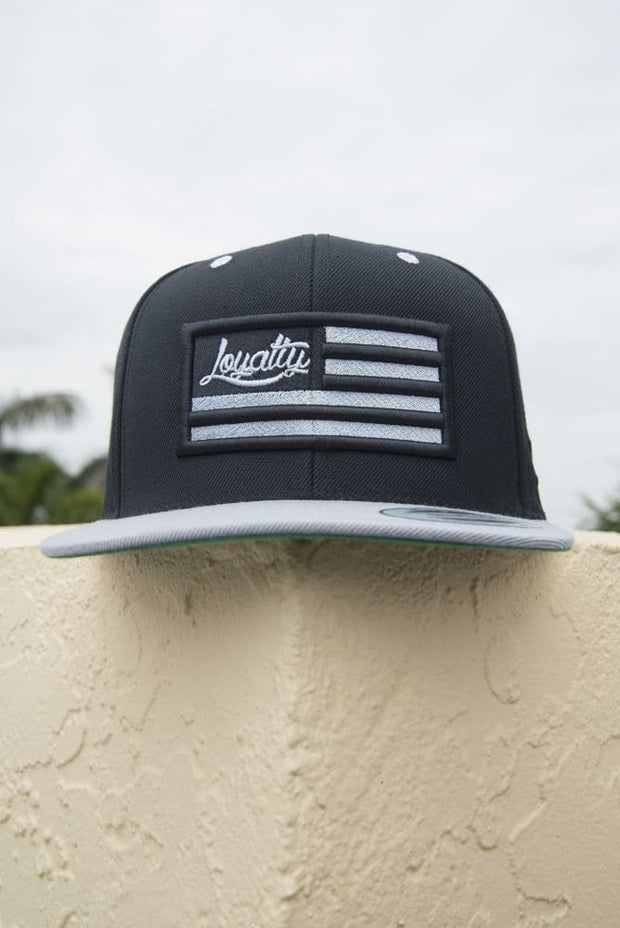 Loyalty Flag Black & Silver Stitch 3D Puff Snapback - Devious Elements Apparel
