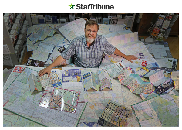 Tom Hedberg surrounded by many of the maps he has made through the 26+ years in the map industry