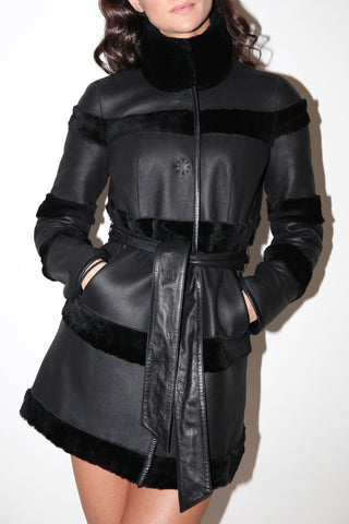 Reversible black leather-fur coat