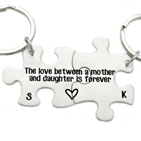 PERSONALIZED INITIAL PUZZLE PIECE KEYCHAIN SET - THE LOVE BETWEEN A MOTHER AND DAUGHTER IS FOREVER