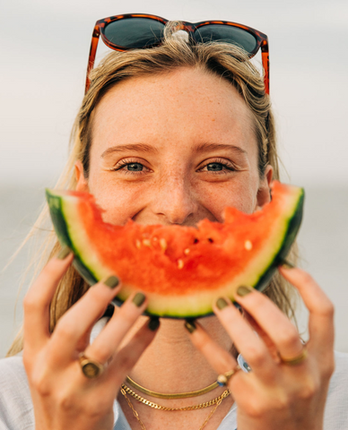 woman with Rheos Wyecreeks floating sunglasses and watermelon smile