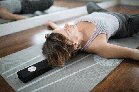 Person laying on Beam | Back relief tool