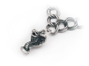 """Snake Eyes"" STERLING SILVER CHARM"