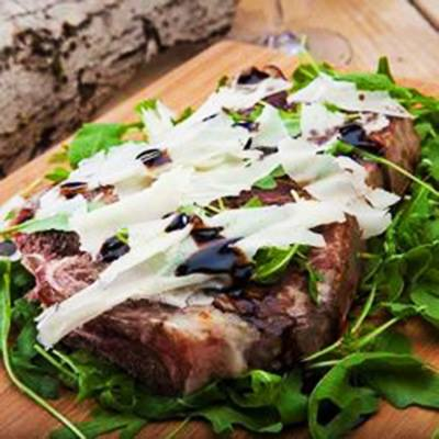 Florentine-style Steak with Arugula, Parmigiano and Organic Balsamic of Monticello