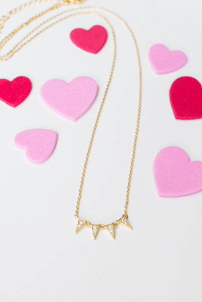 Dainty gold necklace with triangles