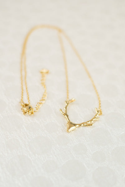 Gold deer antler necklace