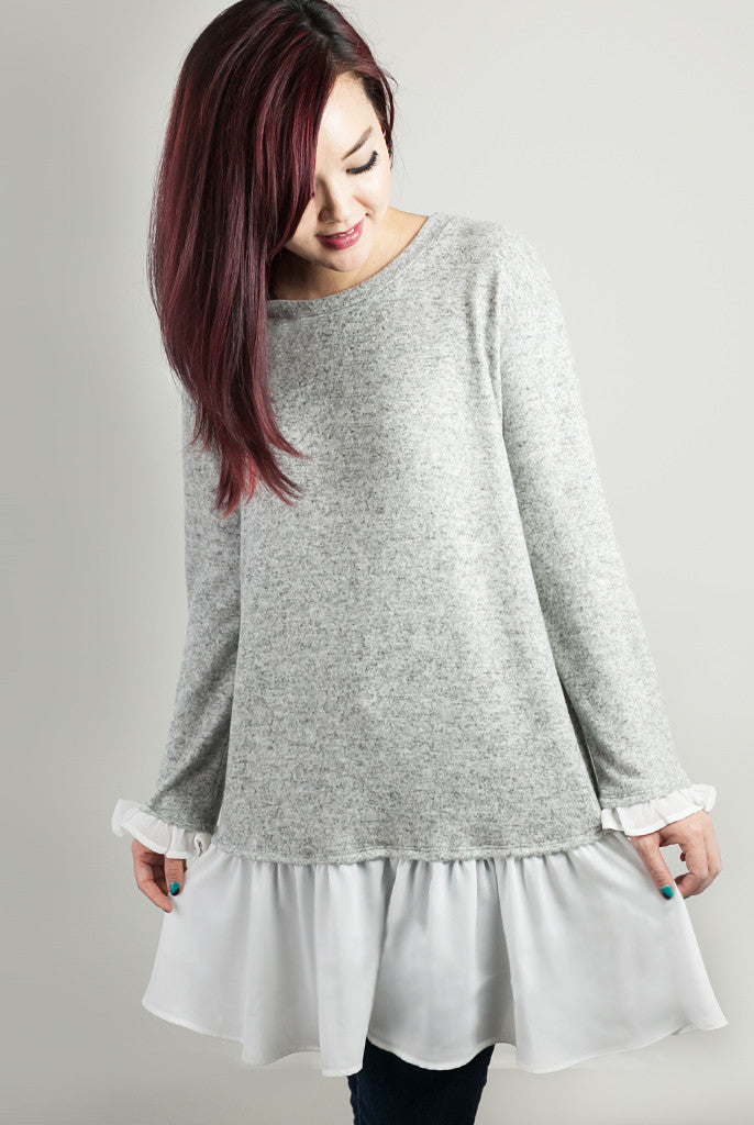 Gray sweater with ruffle trim