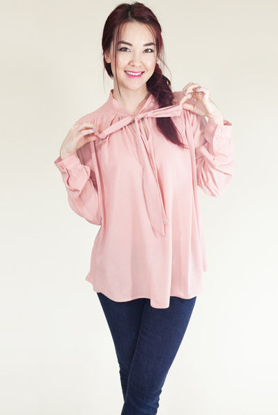 pink blouse with bow