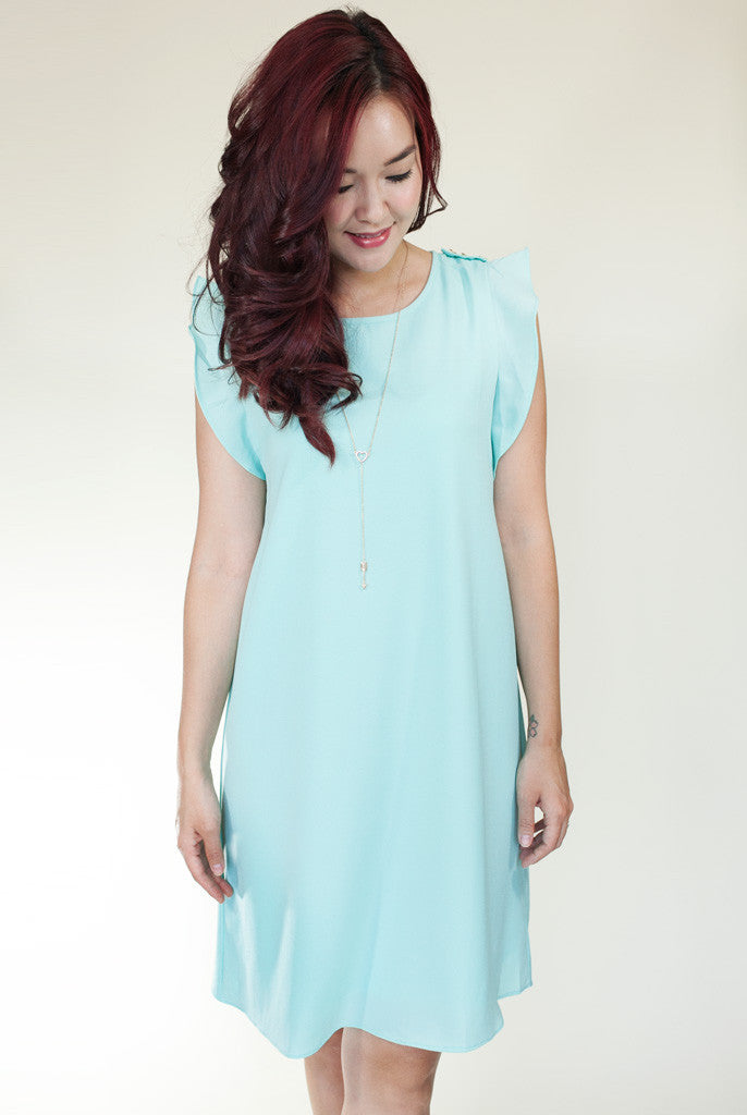 teal dress with ruffle sleeves