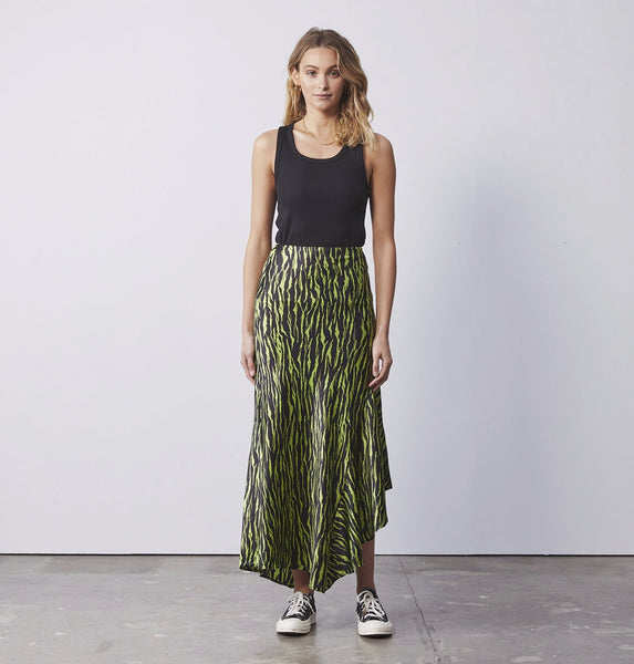 ENA PELLY ASYMMETRICAL SLIP SKIRT IN ANIMAL PRINT GREEN