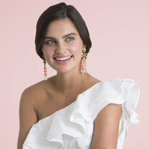 Happy bride wearing one shoulder white dress and Bounkit earrings