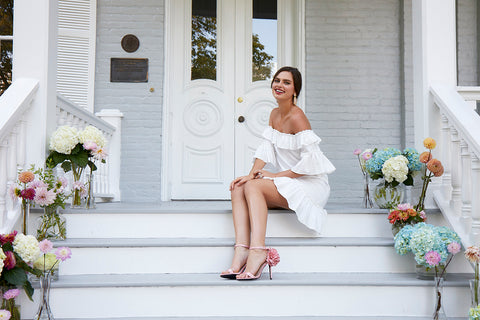 bride on porch in boho chic short white off shoulder wedding reception rehearsal outdoor bachelorette dress