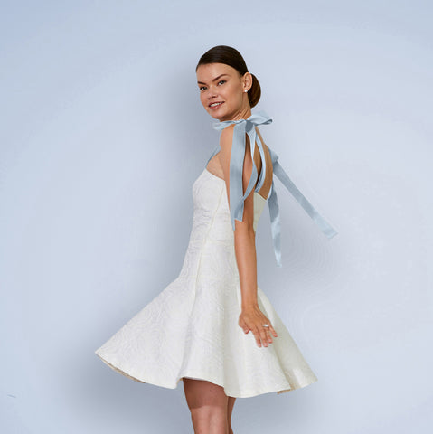 Bride wearing casual simple bridal shower and wedding reception dress with Blue Ribbon straps for second outfit