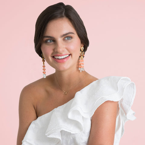 Bride wearing one shoulder white cocktail dress with Bounkit earrings