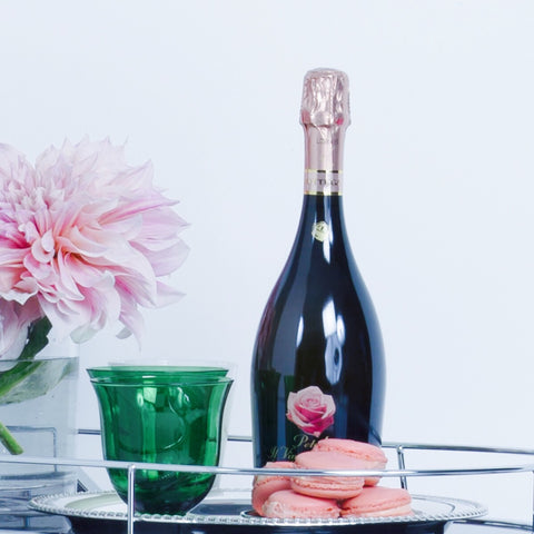 Jane Summers Blog Champagne Bottle French Macarons Green glassware and Dinner Plate Dahlia Flowers