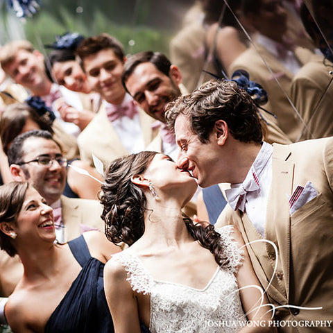 Groom with a General Knot Tie and Pocket Square kissing his bride