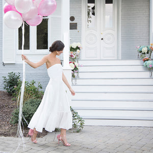 bride in tea length white bridal shower rehearsal dinner simple outdoor fall wedding dress