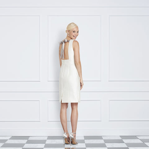 Jane Summers Lisa Little White Bridal Rehearsal Dinner Wedding Reception After Party above knee Sheath Dress with Silver lining and silver ribbon tie at the open back