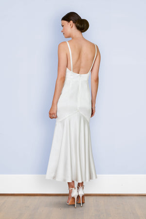 Bride in designer backless bias off white silk tea length rehearsal mermaid twirling first dance wedding dress