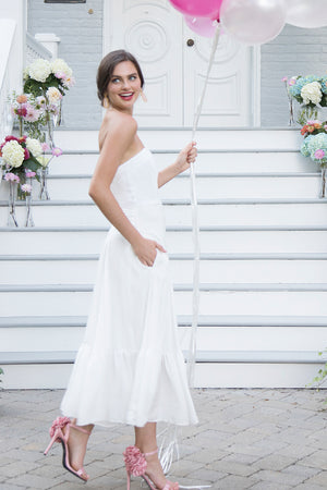 Bride in casual simple white strapless tea length midi ruffle flowy flattering rustic romantic outdoor wedding dress