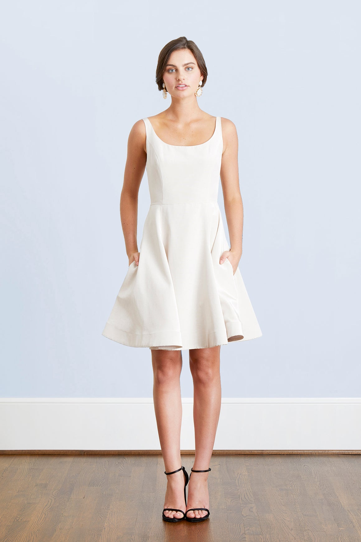Bride in bateau neck open back off white designer short wedding reception twirling dress rehearsal courthouse pockets