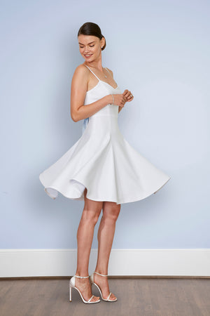 Bride wearing sweetheart neckline short white cocktail dress and elegant after party dress