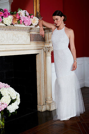 Bride wearing Sequin and Tulle Halter Neck Backless Wedding Dress with flowers