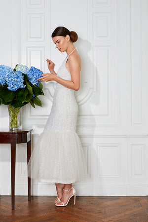 elegant bride in designer modern 20s Gatsby halter cocktail party dress and tea length wedding with hydrangeas