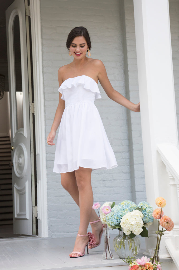 Bride walking in versatile style short casual flirty strapless ruffled engagement photo dress for rehearsal courthouse wedding