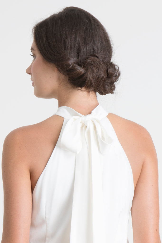close up of neck tie bow of bride wearing Jane Summers princess short white wedding rehearsal dress