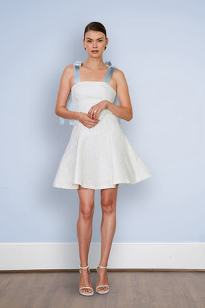 Modern romantic bride wearing short white flirty fun flowy simple casual rustic outdoor courthouse civil wedding dress