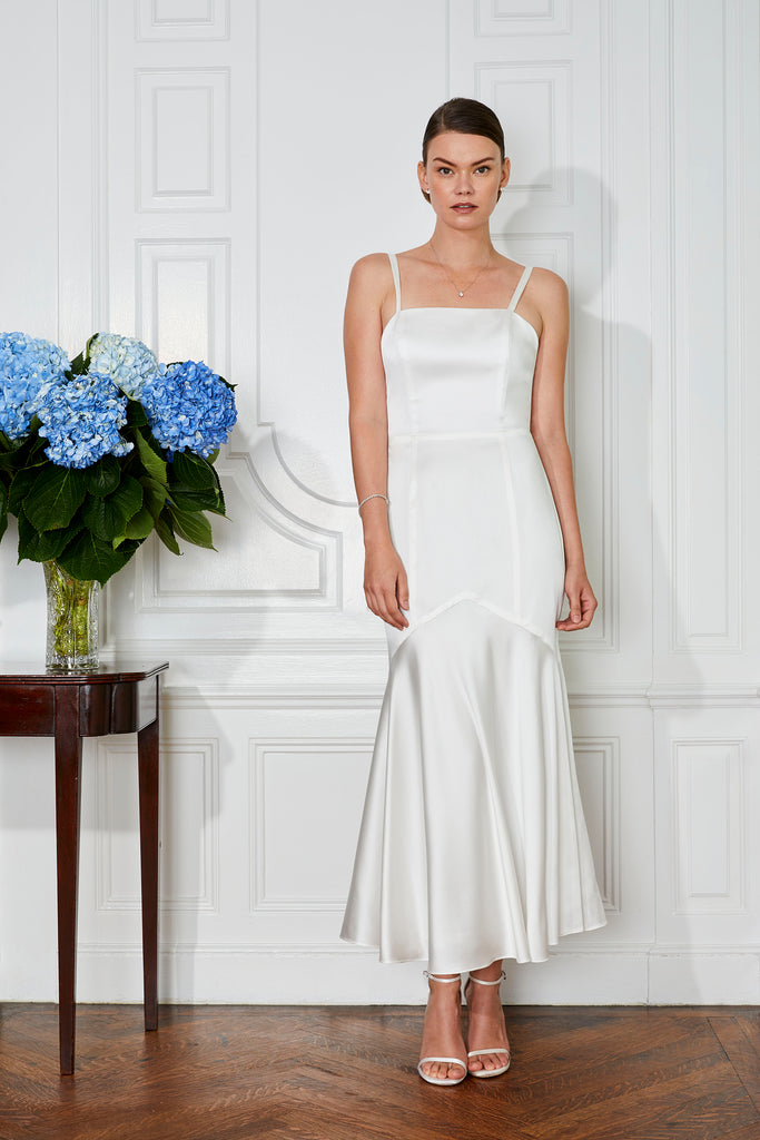 tea length white wedding dress with backless detail and flare skirt for a modern bride