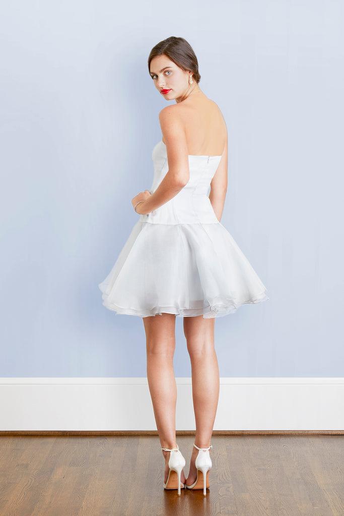 elegant bride in designer cocktail party strapless short white wedding dress alternative with dramatic flowy romantic skirt