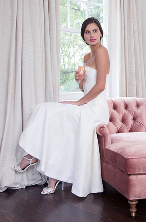 bride wearing white engagement party dress and tea length wedding dress
