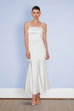 Bride wearing white glamorous Gatsby inspired elegant 30s silk slip dress wedding dress and cocktail party dressr