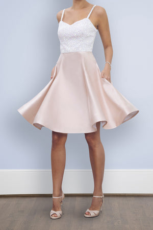 Bride wearing short blush pink flowy twirling first dance wedding rehearsal reception dress with sequins sweetheart neck