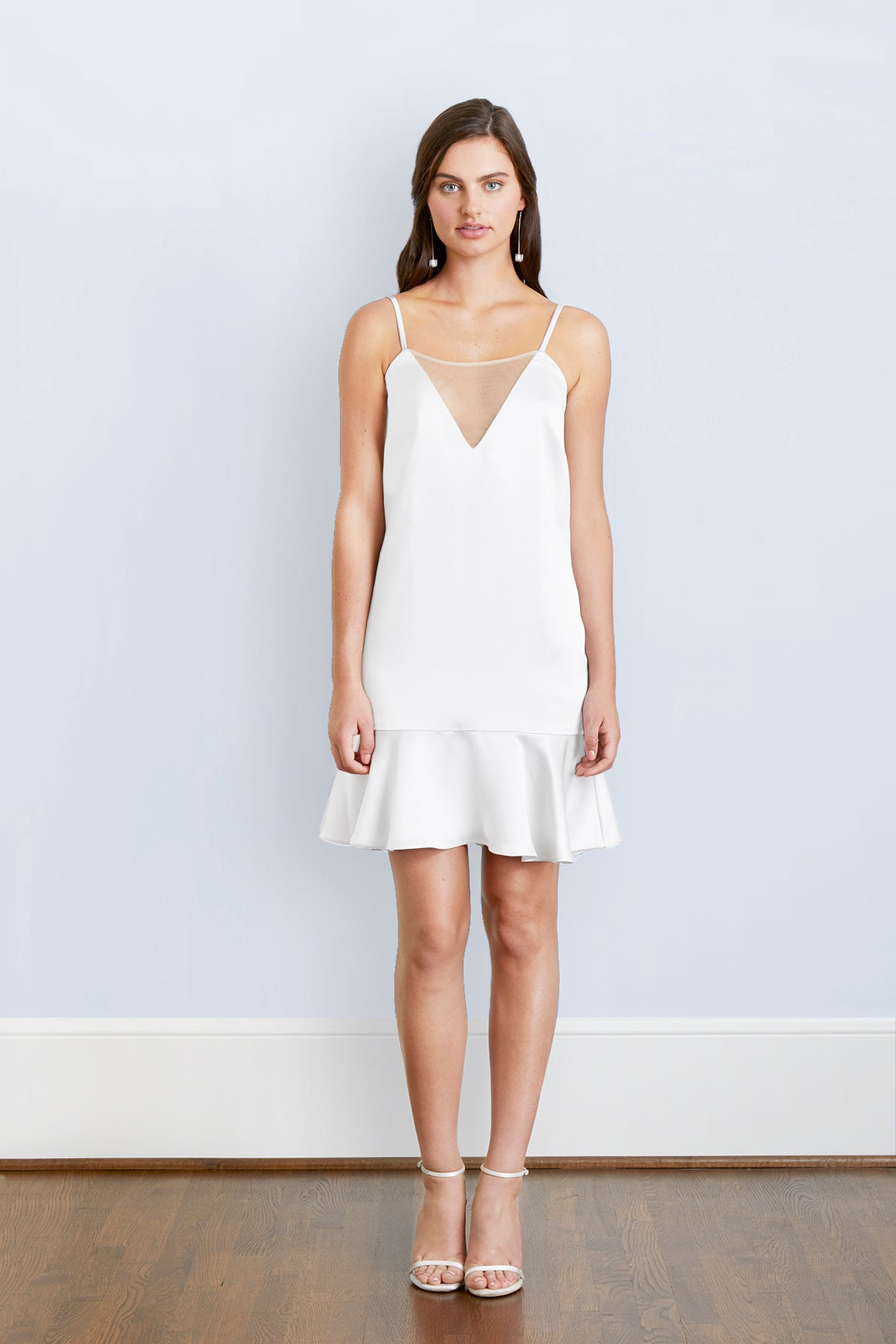 bride wearing designer short flowy white mesh plunge V sexy cocktail hour wedding reception after party dress