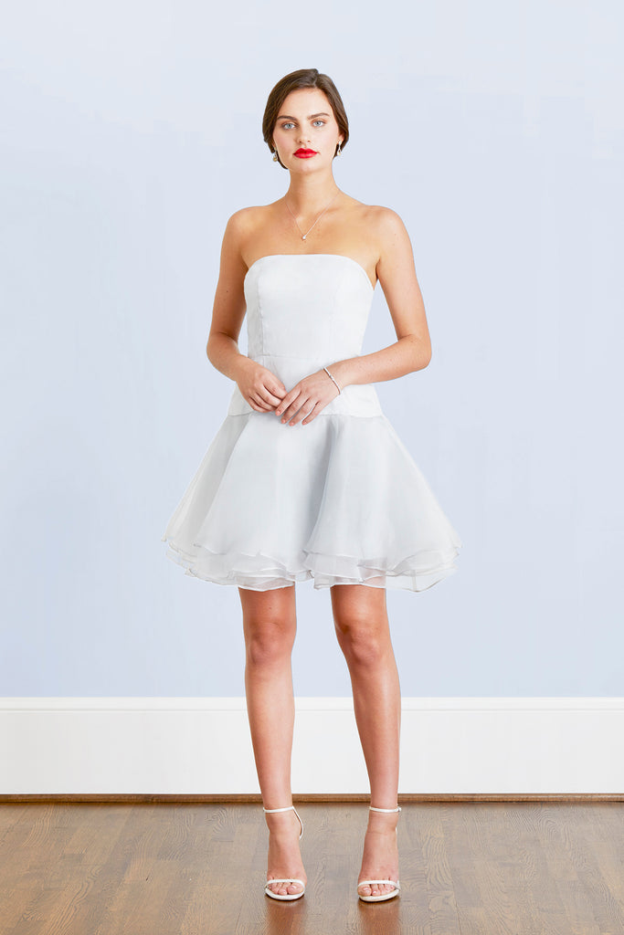 bride in flirty short cocktail dress for an elegant wedding reception unforgettable after party chic cocktail hour