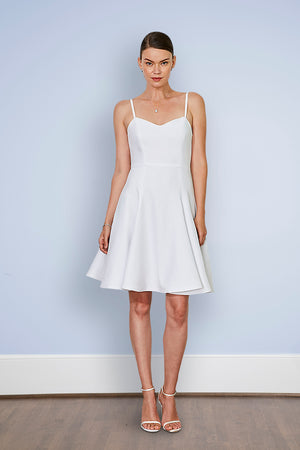 bride wearing sophisticated short white rehearsal dinner & wedding dress with sweetheart neckline