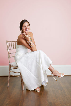 Happy bride wearing strapless midi beach wedding dress and bounkit jewelry